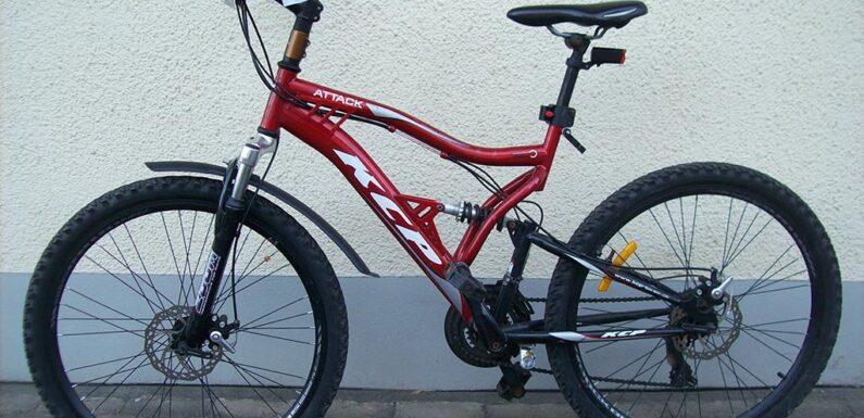 Wem gehört dieses rote Mountainbike?
